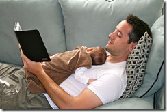 Guy Reading with Baby